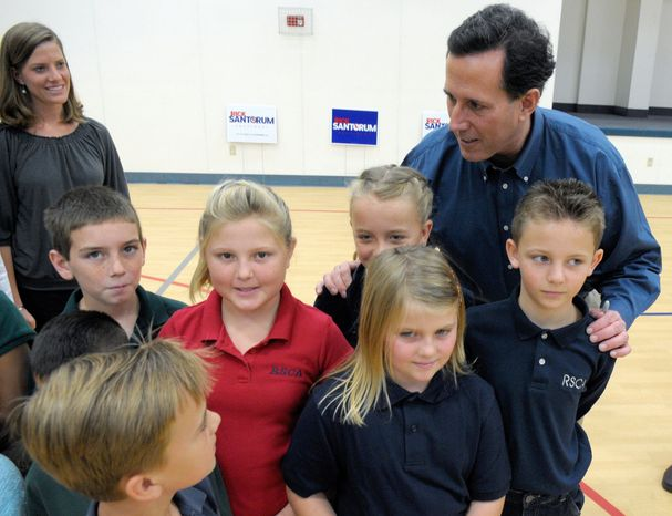 Former Sen. Rick Santorum of Pennsylvania, a Republican presidential candidate, chats with schoolchildren after speaking to backers inside the First Baptist Church of Okeechobee's gymnasium in Okeechobee, Fla., on Tuesday. Some values voters with big families are supporting Mr. Santorum. (Associated Press)