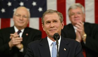 "President George W. Bush delivers his State of the Union address on Jan. 29, 2002, in Washington. Sunday will mark 10 years since that day, when Mr. Bush introduced the phrase ""axis of evil."" (Associated Press)"