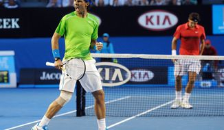 Rafael Nadal (left) celebrates a point win against Roger Federer during their semifinal Jan. 26, 2012, at the Australian Open in Melbourne, Australia. (Associated Press)