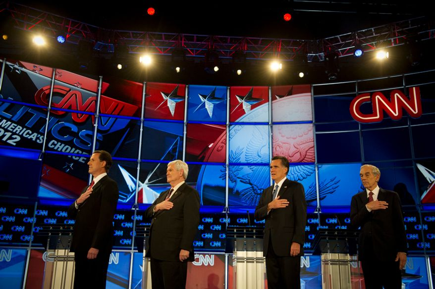 Republican presidential candidates (Left to Right) former Pennsylvania Senator Rick Santorum, former House Speaker Newt Gingrich, former Massachusetts Governor Mitt Romney and Rep. Ron Paul (R-Tex) stand for the singing of the National Anthem as they arrive on stage for the Florida Republican Presidential Debate at the University of North Florida in Jacksonville, Fla., Thursday, January 26, 2012. This is the second and final debate before the Florida Republican primary on Tuesday, January 31, 2012. (Rod Lamkey Jr/ The Washington Times)