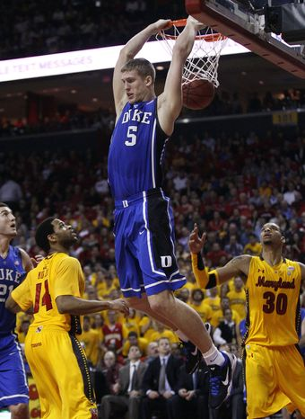 Duke forward Mason Plumlee dunks on Maryland's Sean Mosley and Ashton Pankey in the second half in College Park, Md., Wednesday, Jan. 25, 2012. Plumlee contributed a game-high 23 points to Duke's 74-61 win. (AP Photo/Patrick Semansky)