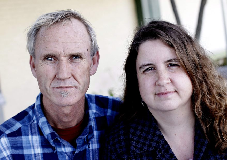 Dan and Vicki McCuistion of Driftwood, Texas, are seen Wednesday, Jan. 18, 2012, in Austin, Texas. The McCuistions have been uninsured throughout their 17 years married. (AP Photo/Eric Gay)