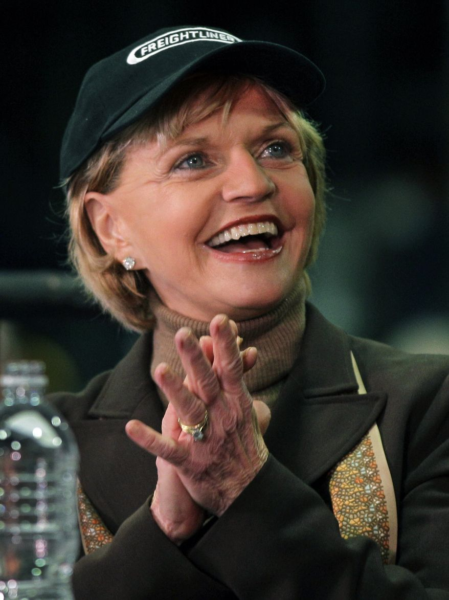 **FILE** North Carolina Gov. Beverly Perdue wears a Freightliner hat as she smiles Jan. 12, 2012, during a news conference at a Freightliner plant in Cleveland, N.C. (Associated Press)