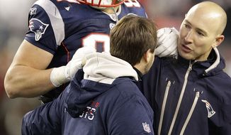 New England Patriots tight end Rob Gronkowski is helped off the field after being injured during the second half of the AFC Championship game against the Baltimore Ravens on Sunday, Jan. 22, 2012, in Foxborough, Mass. (AP Photo/Stephan Savoia)