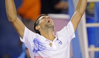 Novak Djokovic of Serbia celebrates after defeating Andy Murray of Britain during their semifinal at the Australian Open, in Melbourne, Australia, early Saturday, Jan. 28, 2012. (AP Photo/Andrew Brownbill)