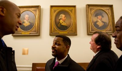 D.C. Council member Michael A. Brown, Council Chairman Kwame R. Brown, D.C. Shadow Senator Michael D. Brown and Council member Vincent B. Orange look at portraits of New Hampshire revolutionaries that hang in the main hall of the New Hampshire State House, Concord, N.H., Friday, Jan. 27, 2012. (Andrew Harnik/The Washington Times)