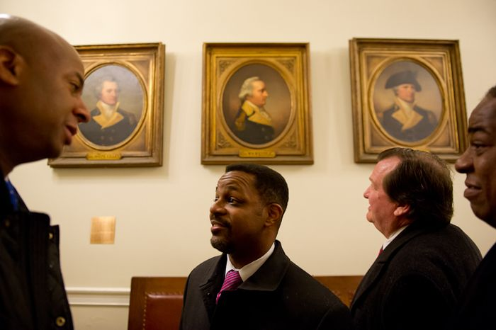 D.C. Council member Michael A. Brown, Council Chairman Kwame R. Brown, D.C. Shadow Senator Michael D. Brown and Council member Vincent B. Orange look at portraits of New Hampshire revolutionaries that hang in the main hall of the New Hampshire State House, Concord, N.H., Friday, Jan. 27, 2012. (Andrew Harnik/The