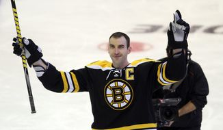 Boston Bruins' Zdeno Chara (33) celebrates after winning the hardest shot event at NHL All Star Skills hockey competition in Ottawa, Ontario, on Saturday, Jan. 28, 2012. (AP Photo/The Canadian Press, Fred Chartrand)