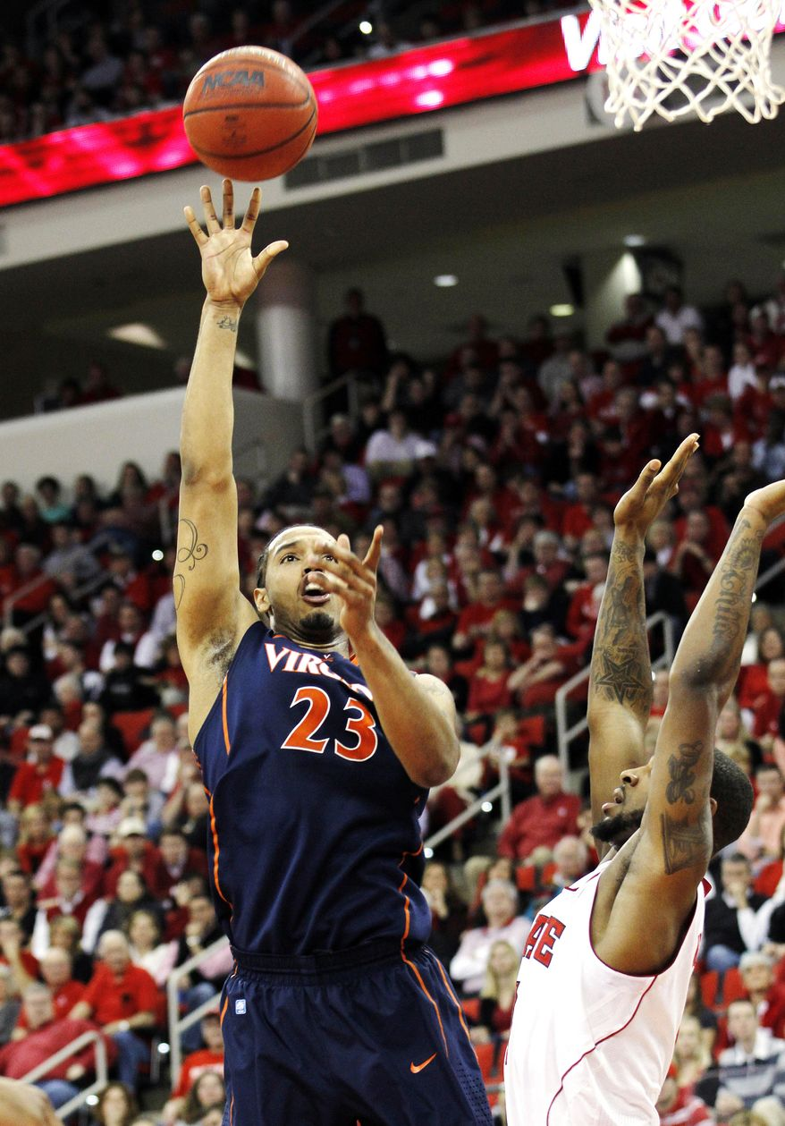 \Virginia's Mike Scott shoots over North Carolina State forward Richard Howell in Raleigh, N.C., Saturday, Jan. 28, 2012. The Cavs won 61-60. (AP Photo/Jim R. Bounds)