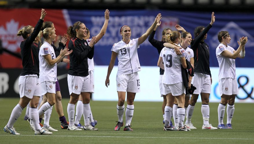 The United States celebrates its 3-0 win over Costa Rica in CONCACAF women's Olympic qualifying action at B.C. Place in Vancouver, British Columbia, Friday, Jan. 27, 2012. (AP Photo/The Canadian Press, Jonathan Hayward)