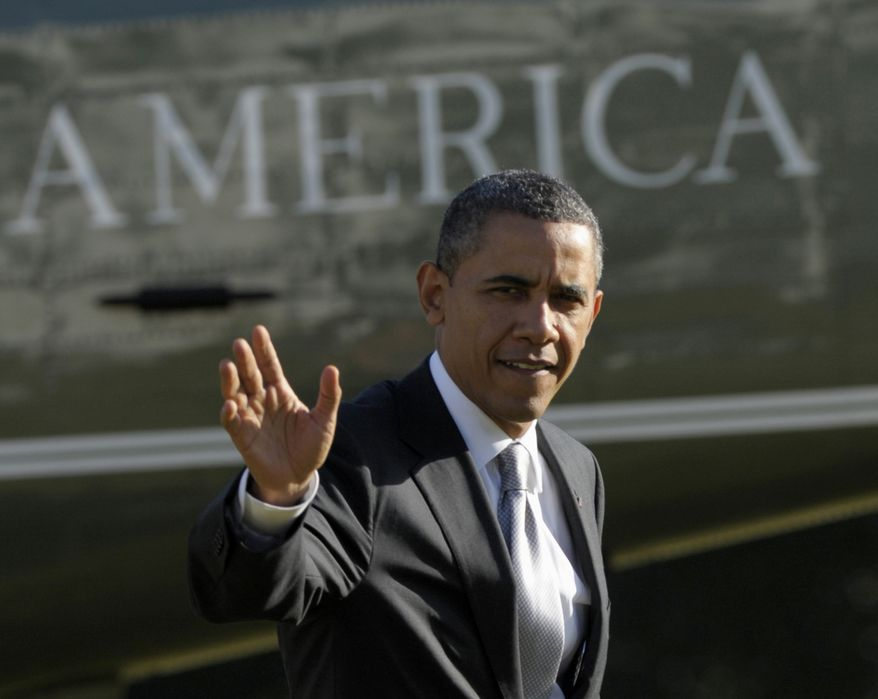 President Barack Obama waves as he walks off of Marine One on the South Lawn of the White House in Washington, Friday, Jan. 27, 2012. (AP Photo/Susan Walsh)