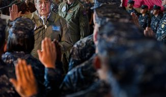 ** FILE ** In this Saturday, Jan. 21, 2012, photo provided by the U.S. Navy, Secretary of Defense Leon E. Panetta, left, re-enlists 21 sailors aboard the aircraft carrier USS Enterprise, at sea. (AP Photo/U.S. Navy, Petty Officer 3rd Class Scott Pittman)