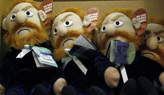 Vincent Van Gogh dolls with removable ears are for sale in the gift shop for the Van Gogh Close Up exhibit at the Philadelphia Museum of Art Friday, Jan. 27, 2012 in Philadelphia. The exhibit opens February 1st. (AP Photo/Alex Brandon)