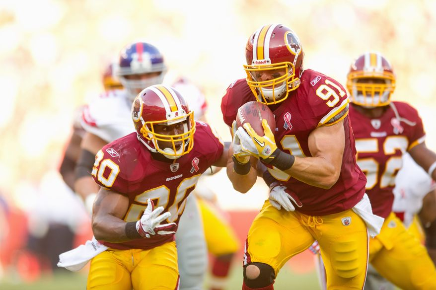 Washington Redskins LB Ryan Kerrigan (91) intercepts a ball and runs it in 9 yards for a touchdown against the New York Giants during the 3rd quarter at FedEx Field in Landover, Md. Sunday, September 11, 2011. (Andrew Harnik / The Washington Times)