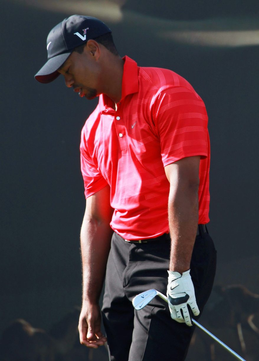 Tiger Woods shot a par 72 on Sunday to finish in a three-way tie for third in gthe Abu Dhabi HSBC Championship. (Associated Press)