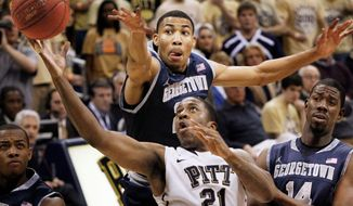 ASSOCIATED PRESS Pittsburgh's Lamar Patterson drives past Georgetown's Otto Porter (top) and Henry Sims during the first half of the Panthers' 72-60 Big East victory Saturday night.