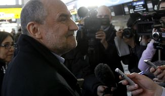 Herman Nackaerts, the deputy director general of the International Atomic Energy Agency in charge of the Iran file, prepares to depart for Iran from the Vienna, Austria, airport on Saturday, Jan. 28, 2012. (AP Photo/Ronald Zak)