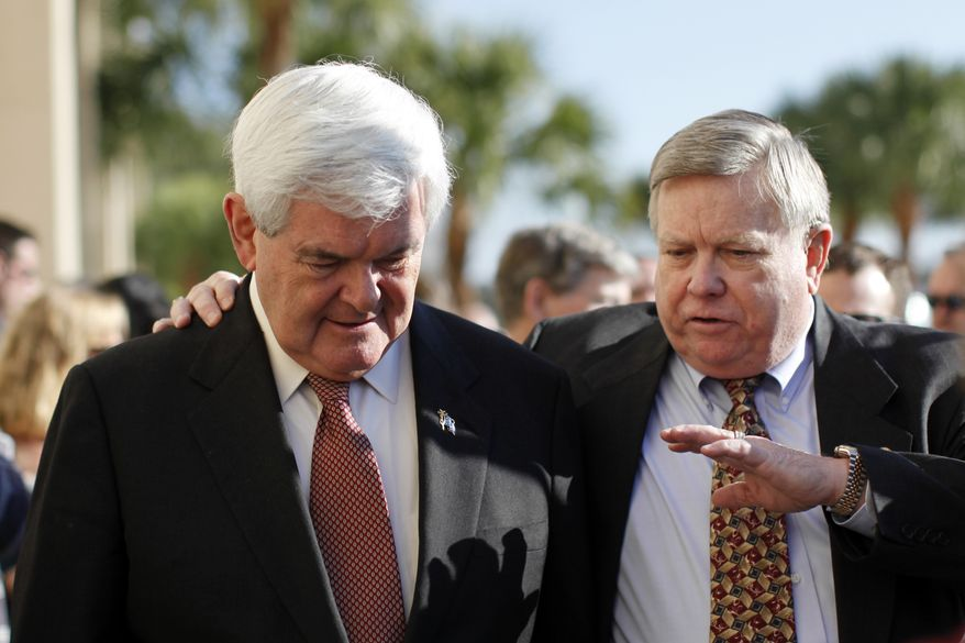 Former House Speaker Newt Gingrich (left) talks with an unidentified man after arriving at Exciting Idlewild Baptist Church on Sunday, Jan. 29, 2012, in Lutz, Fla. (AP Photo/Matt Rourke)
