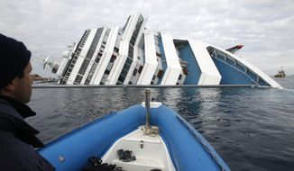 Italian firefighters approach the grounded cruise ship Costa Concordia off the Tuscan island of Giglio, Italy, on Friday, Jan. 27, 2012. (AP Photo/Pier Paolo Cito)