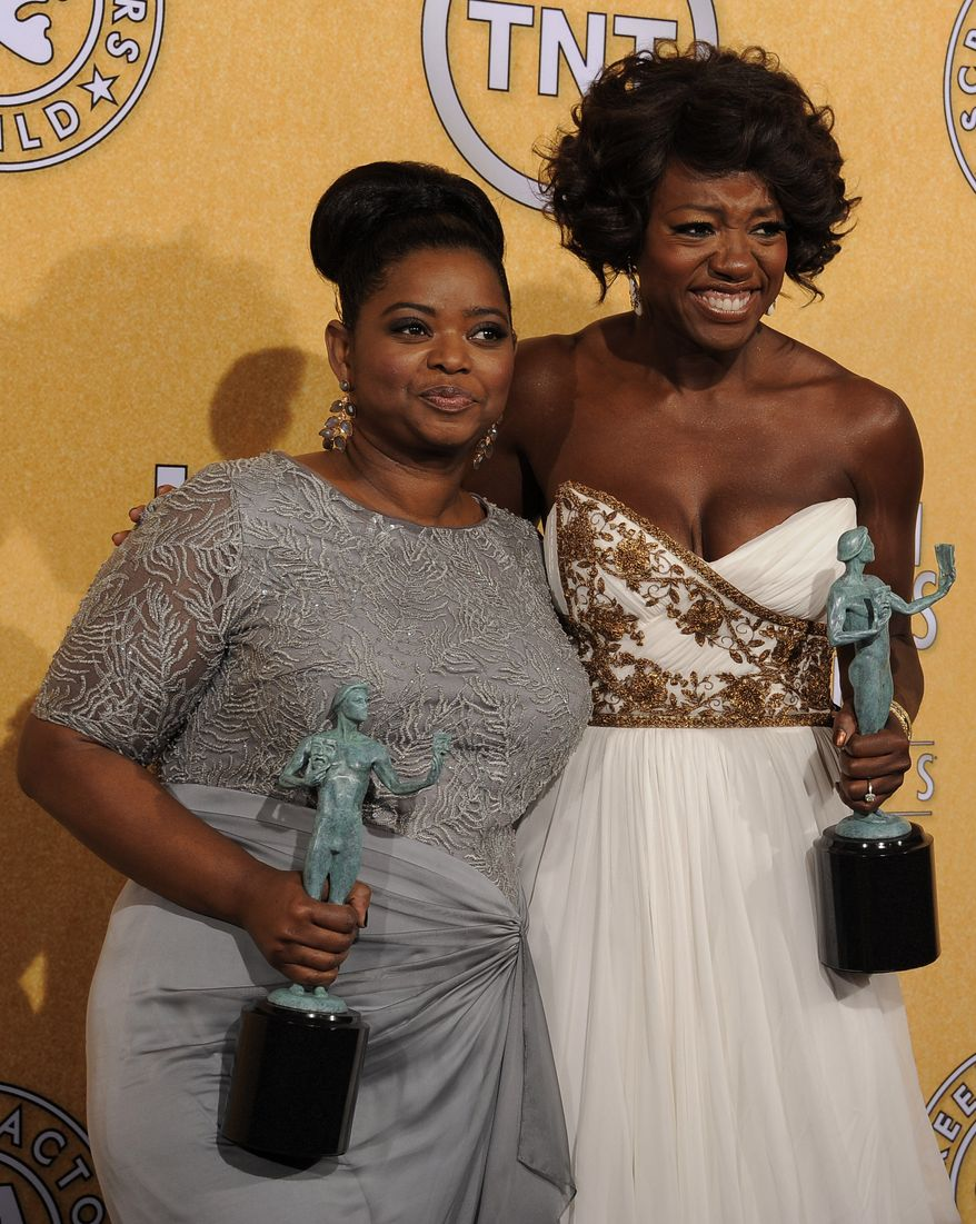"""Octavia Spencer, winner of award for outstanding performance by a female actor in a supporting role for """"The Help,"""" left, and Viola Davis, winner of the award for outstanding performance by a female actor in a leading role for """"The Help,"""" pose backstage at the 18th Annual Screen Actors Guild Awards on Sunday Jan. 29, 2012 in Los Angeles. (AP Photo/Chris Pizzello)"""
