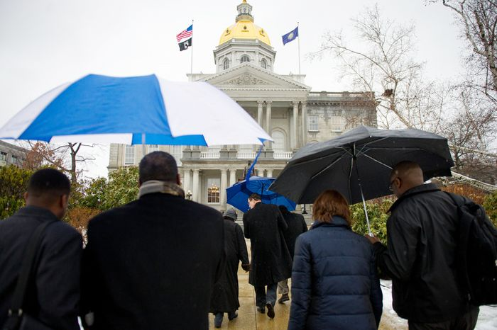 Washington Mayor Vincent C. Gray (center) arrives with D.C. Council members and D.C. citizens at the New Hampshire Statehouse in Concord, N.H., on Friday, Jan. 27, 2012, to try to gain support for D.C. statehood. (Andrew Harnik/The Washington Times)
