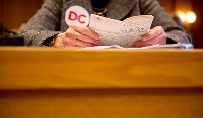 D.C. Council member Mary Cheh, a constitutional scholar, refers to a copy of the U.S. Constitution while advocating for D.C. statehood in front of the New Hampshire House of Representatives Committee on State-Federal Relations and Veterans Affairs at the New Hampshire Statehouse. (Andrew Harnik/The Washington Times)