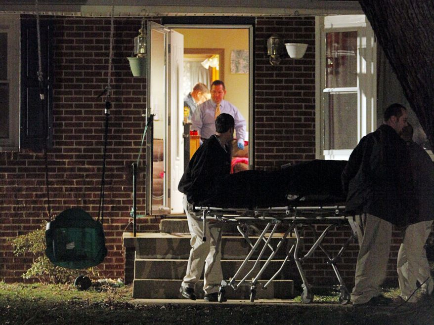 Multiple bodies are removed from a home in Mechanicsville, Va., near Richmond, on Saturday, Jan. 28, 2012. Authorities are investigating the suspicious deaths of a 40-year-old man and two 3-year-old girls, all related. (AP Photo/Eva Russo, Richmond Times-Dispatch)