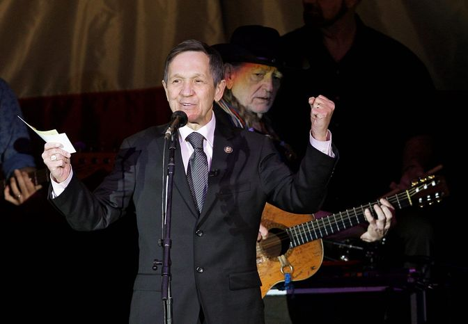 U.S. Rep. Denis Kucinich, D-Ohio, left, introduces Willie Nelson, background, during his fundraiser in Lorain, Ohio Sunday, Jan. 29, 2012. Redistricting has pitted Kucinich against Toledo area congresswoman Marcy Kaptur in the March primary. (AP Photo/Mark Duncan)
