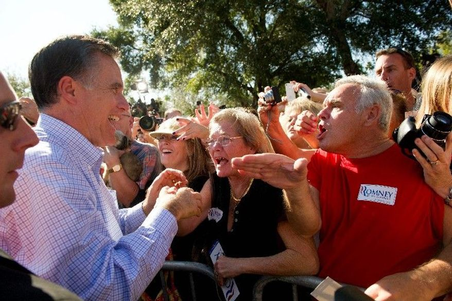 With one day until Florida holds its Republican presidential primary, former Massachusetts Gov. Mitt Romney shakes hands with supporters as he makes his exit during a rally at Pioneer Park in Dunedin, Fla., on Monday. One poll shows Mr. Romney leading with 47 percent of the vote. (Rod Lamkey Jr./The Washington Times)