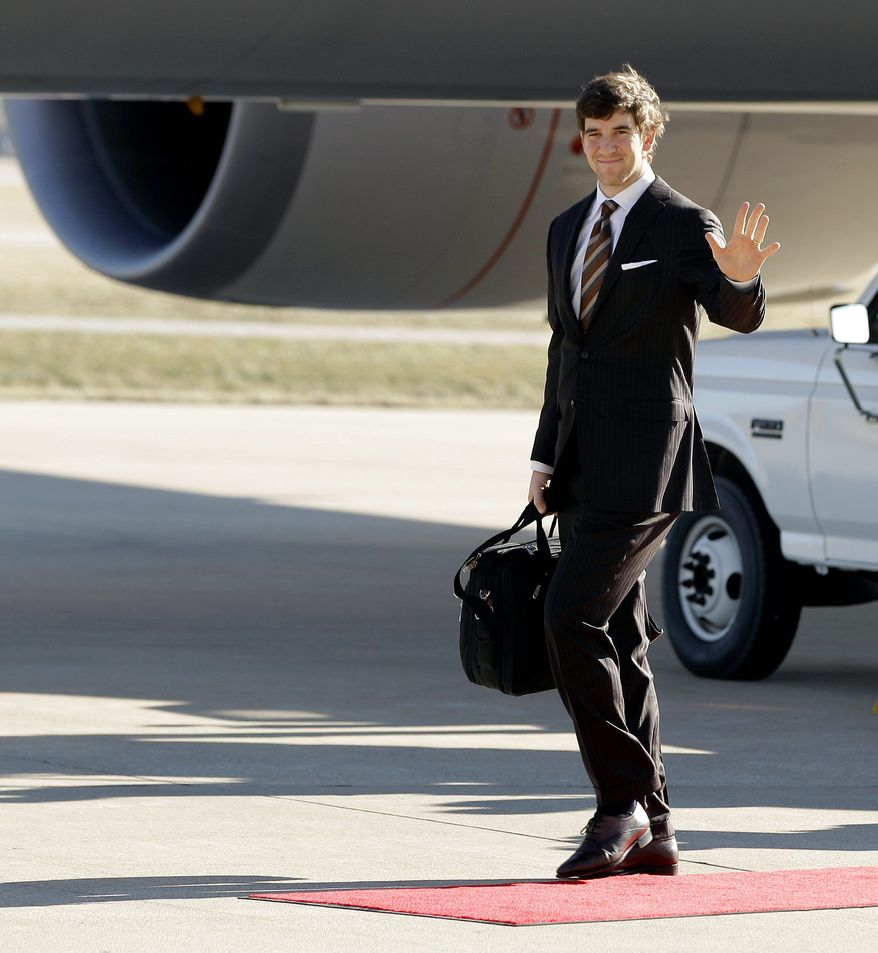 New York Giants quarterback Eli Manning arrives in Indianapolis for Super Bowl XLVI. The New England Patriots flew in Sunday. (Associated Press)