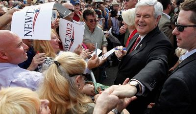 Republican presidential candidate Newt Gingrich, with wife Callista beside him, meets with potential voters Wednesday at Wings Plus Restaurant in Coral Springs, Fla. The state's GOP primary is Tuesday. (Associated Press)