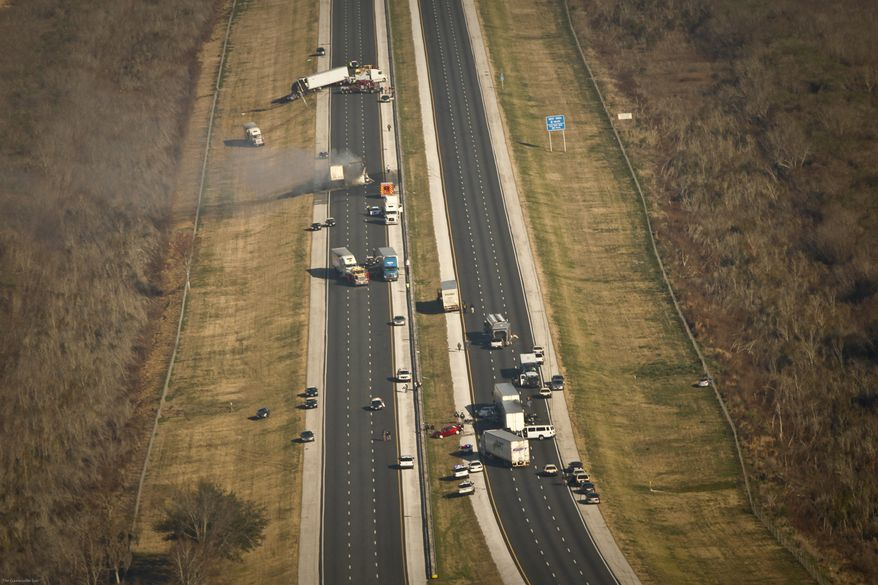 An aerial view shows Interstate 75 in Gainesville, Fla., on Sunday, Jan. 29, 2012, after 11 people died as a result of multiple crashes caused by fog and smoke from a wildfire. (Associated Press/The Gainesville Sun)