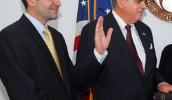 ** FILE ** Sam LaHood (left) looks on as his father, Ray LaHood, is sworn in as secretary of transportation in January 2009. (AP Photo/U.S. Department of Transportation)