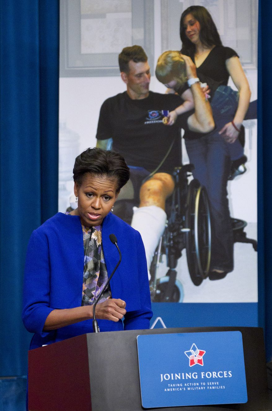 First lady Michelle Obama speaks Jan. 30, 2012, at the Labor Department in Washington to announce proposed rules to help caregivers of wounded, ill and injured service members and veterans. (Associated Press)