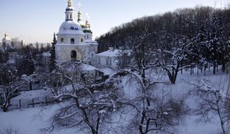 Snow surrounds an Orthodox Christian cathedral in Kiev on Monday, Jan. 30, 2012. Ukraine's Emergency Situations Ministry said 18 people had died of hypothermia and nearly 500 people had sought medical help for frostbite and hypothermia in just three days last week. (AP Photo/Efrem Lukatsky)