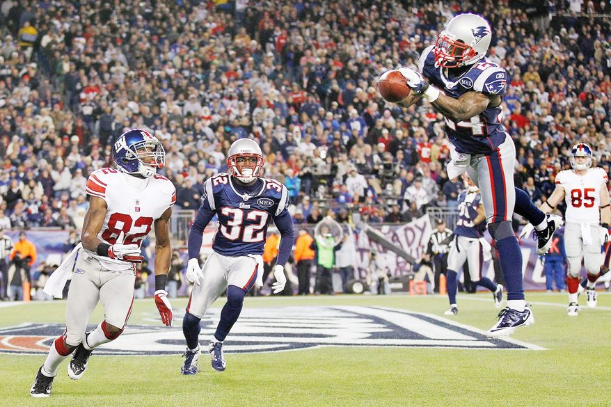 Cornerback Kyle Arrington tied for the NFL lead in interceptions with seven, including this one against the New York Giants on Nov. 6. (Associated Press)