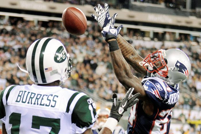New England Patriots cornerback Kyle Arrington breaks up a pass intended for New York Jets wide receiver Plaxico Burress during the third quarter of an NFL game Sunday, Nov. 13, 2011 in East Rutherford, N.J. (AP Photo/Bill Kostroun)
