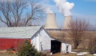** FILE ** Steam vapor rises from the cooling towers of Exelon Corp.'s nuclear plant in Byron, Ill, in March 2011. (AP Photo/Robert Ray, File)