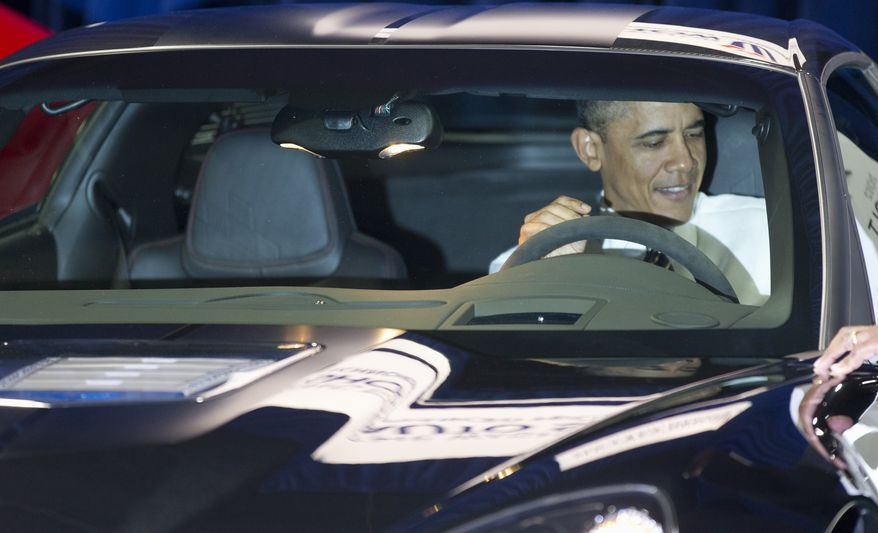 President Obama sits Jan., 31, 2012, inside a Chevrolet Corvette ZR1 during his visit to the Washington Auto Show at the Washington Convention Center in Washington. (Associated Press)