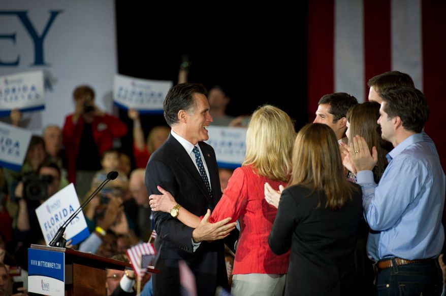 Republican presidential candidate and former Massachusetts Gov. Mitt Romney is joined by his wife Ann and other family members on stage as he arrives to deliver his speech to the crowd at the Tampa Convention Center in Tampa, Fla., Tuesday, Jan. 31, 2012. (Rod Lamkey Jr./The Washington Times)