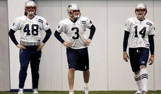 New England Patriots kicker Stephen Gostkowski (3) streches with long snapper Danny Aiken (48) and punter Zoltan Mesko (14) during practice on Wednesday, Feb. 1, 2012, in Indianapolis. The Patriots are scheduled to face the New York Giants in NFL football Super Bowl XLVI on Feb. 5. (AP Photo/Mark Humphrey)