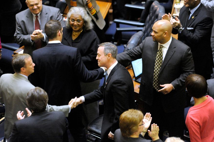 "Maryland Gov Martin O'Malley (center) shakes hands with lawmakers before delivering his State of the State speech Wednesday in Annapolis. Mr. O'Malley reiterated his call for tax increases to fund what he considers necessary programs. ""There are costs and there are values,"" he said. ""We cannot kid ourselves into thinking that by failing to invest in our future we are somehow saving resources."" (Associated Press)"