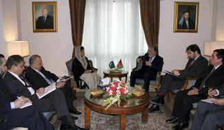 Pakistani Foreign Minister Hina Rabbani Khar (center left) talks with her Afghan counterpart, Zalmai Rasool (center right), during their meeting in Kabul, Afghanistan, on Wednesday, Feb. 1, 2012. (AP Photo/S. Sabawoon, Pool)
