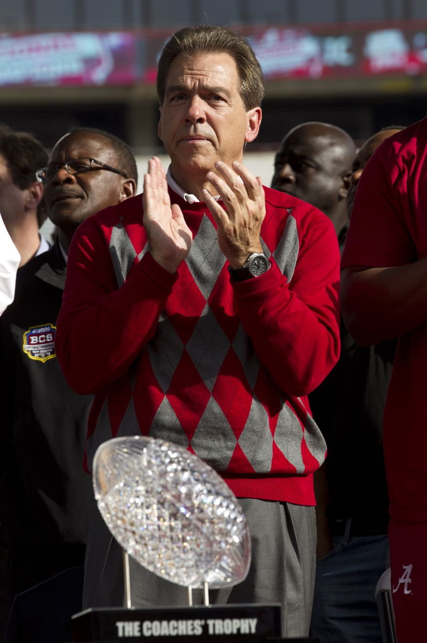 Alabama coach Nick Saban applauds during ceremonies at Bryant Denny Stadium in Tuscaloosa, Ala., Saturday, Jan. 21, 2012. Alabama celebrated its 14th national championship with a 21-0 win over LSU in the BCS Championship game in New Orleans on Jan. 9th. (AP Photo/Dave Martin)
