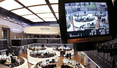 The stock market is seen Feb. 1, 2012, on a video view finder in Frankfurt, Germany, after the EU Commission announced not to allow a merger of Deutsche Boerse with the NYSE. (Associated Press)