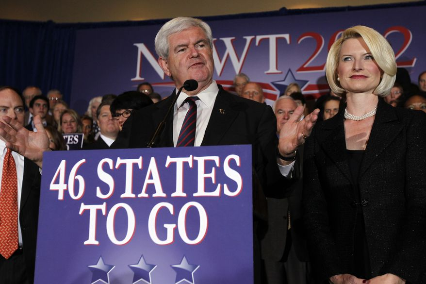 Republican presidential candidate and former House Speaker Newt Gingrich, accompanied by his wife, Callista, speaks Jan. 31, 2012, during a Florida Republican presidential primary night rally in Orlando, Fla. (Associated Press)