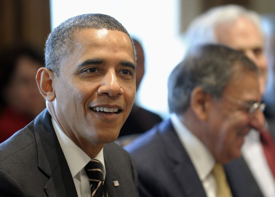 ** FILE ** President Barack Obama, sitting next to Defense Secretary Leon Panetta, right, speaks during a cabinet meeting in the Cabinet Room of the White House in Washington, Tuesday, Jan. 31, 2012. (AP Photo/Susan Walsh)