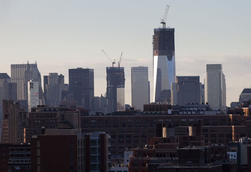 One World Trade Center, now 90 stories high and on its way to being the nation's tallest building, stands above the New York skyline, Monday, Jan. 30, 2012. The Port Authority of New York and New Jersey is aiming for a completion date in the fall of 2013. (AP Photo/Mark Lennihan)
