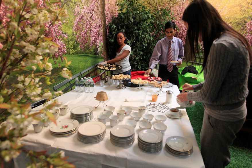 "High tea is served one afternoon in Park Here. Other events might include a movie on the lawn or a ping-pong tournament. The free-to-visit park will close Feb. 15 and return to its primary use as a ""pop-up"" business venue. (Associated Press)"