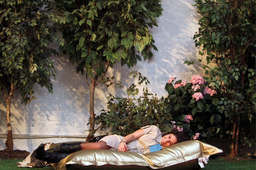 It's springtime in New York, at least in Park Here, a temporary indoor park in lower Manhattan where the temperature is a balmy 75 and recorded nature sounds play amid blossoming bushes. (Associated Press)